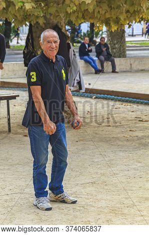 Cannes, France - October 17, 2013: Senior Man Plays Petanque With A Metal Ball In A Park
