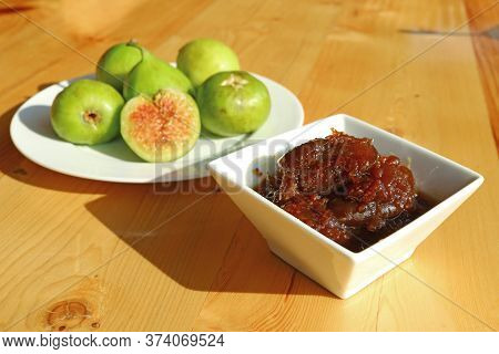 Tasty Homemade Fig Jam With A Plate Of Green Fresh Figs In The Backdrop
