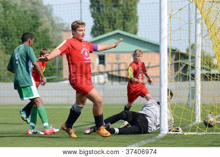 KAPOSVAR, HUNGARY - SEPTEMBER 22: Unidentified players in action at the Hungarian Championship under 15 game between Rakoczi (green) and Mezga FC (red) September 22, 2012 in Kaposvar, Hungary.