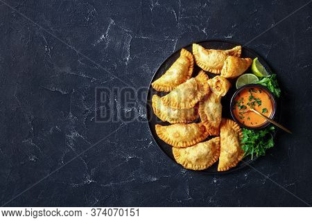 Delicious Deep Fried Buffalo Chicken Empanadas With Low Calorie Dip On A Black Platter On A Concrete