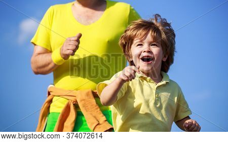 Father And Son Play Sports And Run. Healthy Sport Activity For Children. Sport For Kids, Active Chil