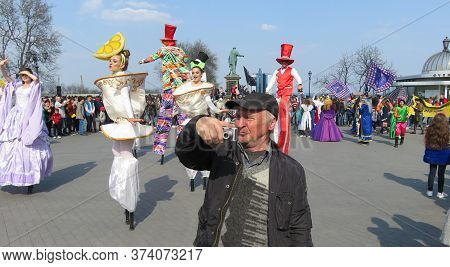 Odessa, Ukraine - 04 01 2019: Reporting Old Photographer In Front Of Puppet Princesses In White Clot