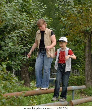 Boy With Mother Outdoor Sports
