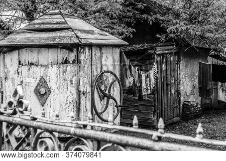 Old Wooden Well In The Ukrainian Village. Vintage Rural Architectural Detail.