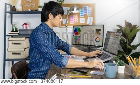 Asian Designer Or Creative Occupation Design Studio Artist Working On Graphic Computer At The Office
