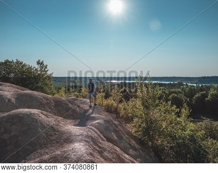 Tourist And Beauty Nature Rock Landscape, Horizontal Photo, Solo Travel And Vacation Concept.