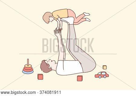 Family, Fatherhood, Childhood, Play, Recreation, Leisure Concept. Joyful Young Man Dad Lying On Carp