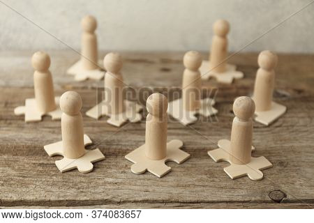 Wooden Figures On Puzzles. People Analytics And Optimization, Team Building. Group Connection In Bus