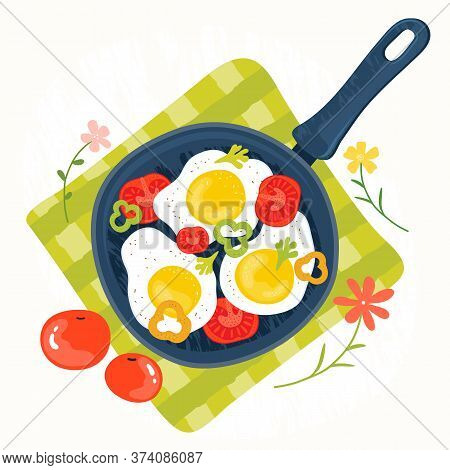 Fried Eggs In A Frying Pan With Vegetables, Tomatoes, Peppers. Healthy Brunch On A Table. Fresh Home
