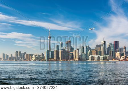 Toronto Skyline With Cn Tower Over Ontario Lake, Canada