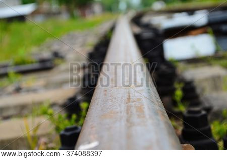 Abandoned Rails Of An Abandoned Railway In The Forest