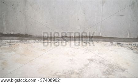Concrete Floor Before Work. The Concrete Floor In The Apartment Is Ready For Processing. Ready Floor