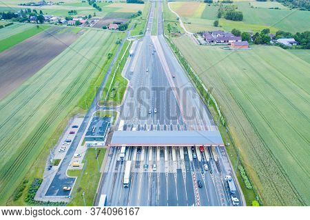Car Traffic Transportation On Multiple Lanes Highway Road And Toll Collection Gate, Drone Aerial Top