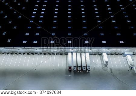 Night Loading Dock At A Warehouse. Modern Logistics Center. Docking Stations Of A Distribution Cente