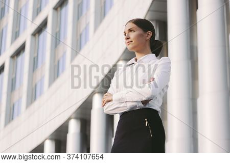 Portrait Young Attractive Confident Business Woman In Suit Keep Arms Crossed And Look Away Near Offi
