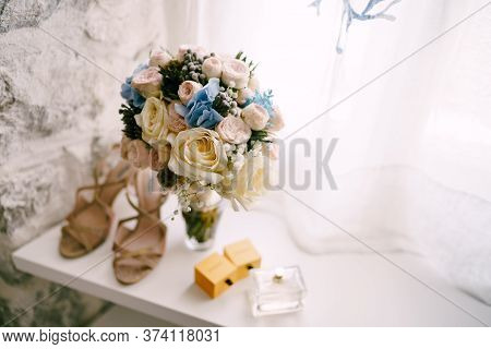 Bridal Bouquet Of White And Pink Roses, Babys Breathe, Scabiosa, Hortense And White Ribbons In A Bri