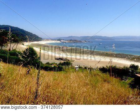 Beautiful Wild Beach Panorama. White Sand And Blue Water. Islas Cíes, Galicia, Spain