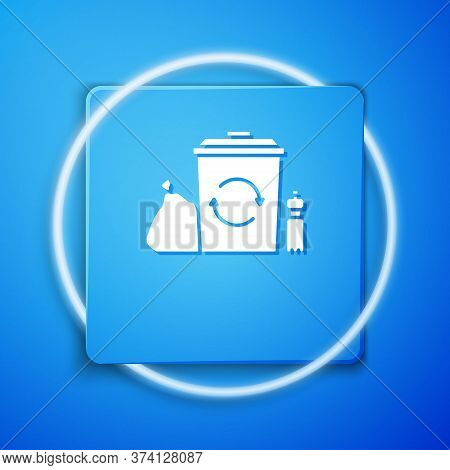 White Recycle Bin With Recycle Symbol Icon Isolated On Blue Background. Trash Can Icon. Garbage Bin