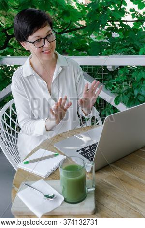 Glass Cup Of Green Matcha Late Coffee Or Tea Stay Near Workplace Of Freelancer Or Blogger. Concept O