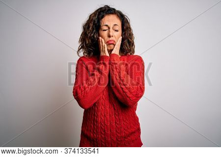 Middle age brunette woman wearing casual sweater standing over isolated white background Tired hands covering face, depression and sadness, upset and irritated for problem