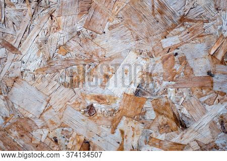 Texture Of Wood-fiber Plate Of Oversipid Sawdust. Top View Of Osb Wood Veneer Background, Tight, Sea