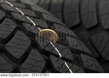 Close Up Picture Of Brand New Black Automobile Tyre