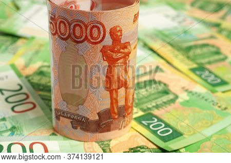 Russian Banknote 5000 Rubles Is On The Field Of Banknotes 200 Rubles. Close-up