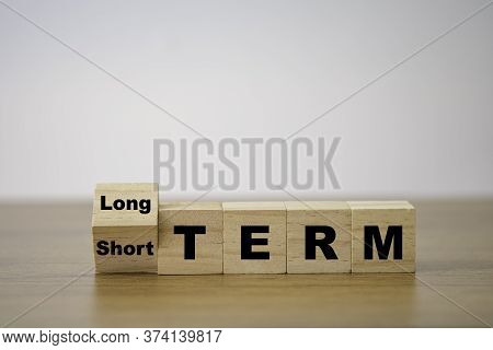 Flipping Od Wooden Cube Block For Change Short Term To Long Term. Business Investment Concept.