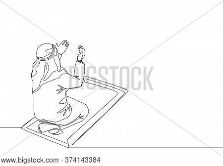 One Continuous Line Drawing Of Muslim Person Raise And Open Hands Praying On Sajadah, From Rear View