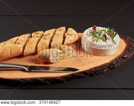 Baked Camembert With Walnuts, Rosemary Stalks And Garlic Cloves, Served With Crusty Garlic Gread, On