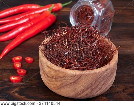An Olive Wood Bowl Filled With Thin Threads Of Sun-dried Red Chili Also Known As Angel Hair Chili, H