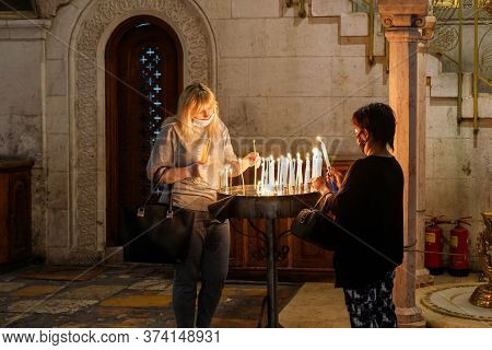Jerusalem, Israel, June 13, 2020 : Believers Light Candles In The Church Of The Holy Sepulchre In Th