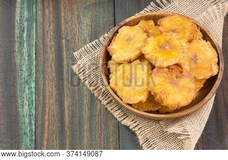Patacon Or Toston, Fried And Flattened Pieces Of Green Plantains, A Traditional Snack Or Accompanime