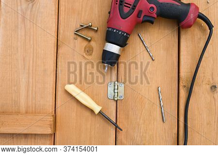 Work Tools Lie On A Flat Wooden Surface