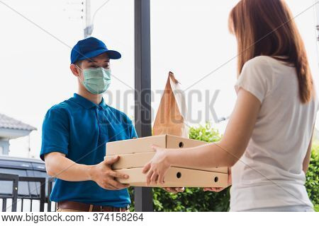 Asian Delivery Express Courier Young Man Giving Paper Bags Fast Food And Pizza Box To Woman Customer