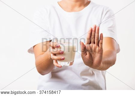 Closeup Woman Raises A Hand To Stop Sign Use Hand Holding Glass Milk She Is Bad Stomach Ache Has Bad