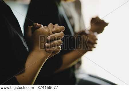 Three People Pray And Praising God Together