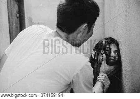 Man Beating Up His Wife Illustrating Domestic Violence.