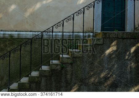 Old Stone Steps With Wrought Iron Railings Close Up