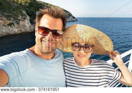 Beautiful, Romantic Caucasian Couple Taking Selfie Self Portrait Photo On Summer Vacations Traveling