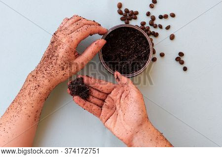Top View Of Woman Hands And Jar With Roasted Coffee Bean Scrub And Sea Salt On Mint Background. Reju