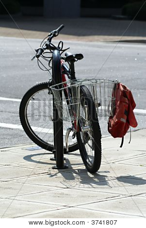 Bicycle Locked Up And Parked.