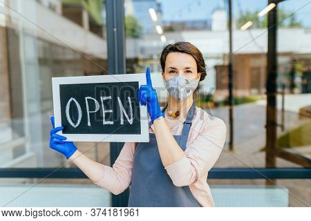 Portrait Of Welcoming Grocery Shop Female Owner Outdoor. Business Woman Worker In Apron Protective M