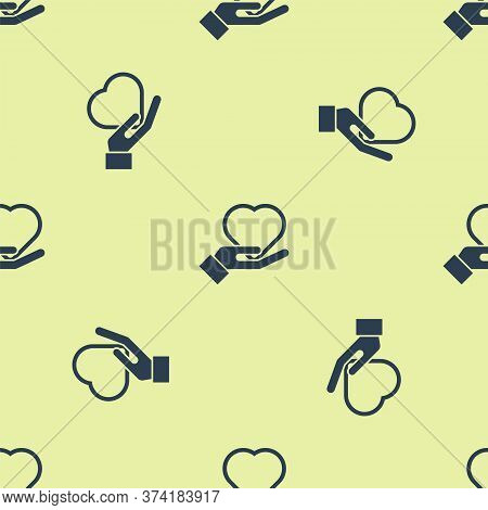 Blue Heart On Hand Icon Isolated Seamless Pattern On Yellow Background. Hand Giving Love Symbol. Val