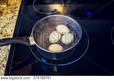 A Pot Of Organic Eggs Boiling On A Stove