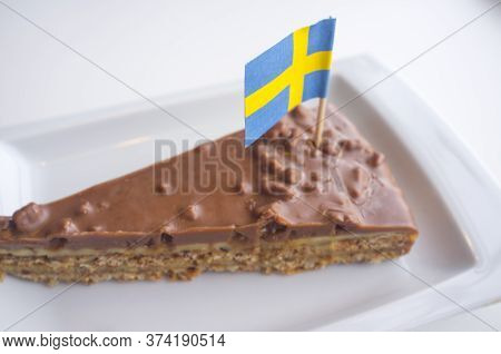 Daim Chocolate Cake With The Flag Of Sweden. Closeup