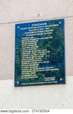 Ostrow Mazowiecka, Poland - June 2, 2020: Plaque Commemorating Fallen Firefighters In The Fight Agai