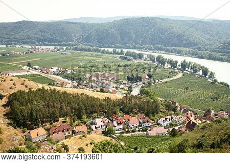 Picturesque European Town Far Away. Scenic Mountain Landscape With Small Old Beautiful Village. Danu
