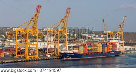 Bridgetown Port, Barbados, West Indies - May 16, 2020: Bridgetown Port With Loading Cranes And Cargo
