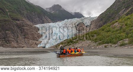 Davidson Glacier, Alaska, Us - June 29, 2018: Tourists And A Guide Sailing In A Canoe Towards Davids